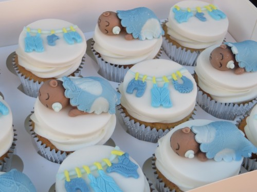 sleeping baby clothes baby shower cupcakes 500x375 The
